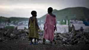 Congolese girls displaced by war stand on the outskirts of a makeshift camp near Goma in eastern Congo in February, 2009.