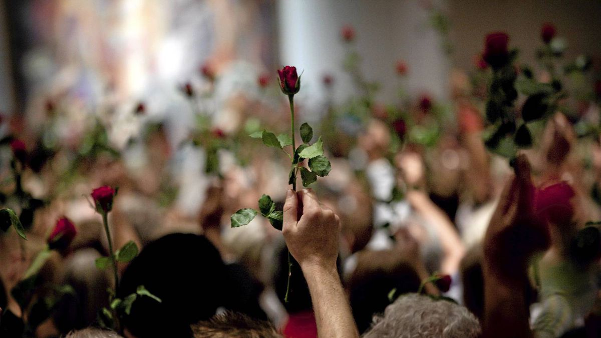 People hold up red roses during a memorial service for the victims of the bomb and shooting massacre, organized by the Norwegian Labour party and its youth organization, AUF, in Oslo, Friday July 29, 2011.