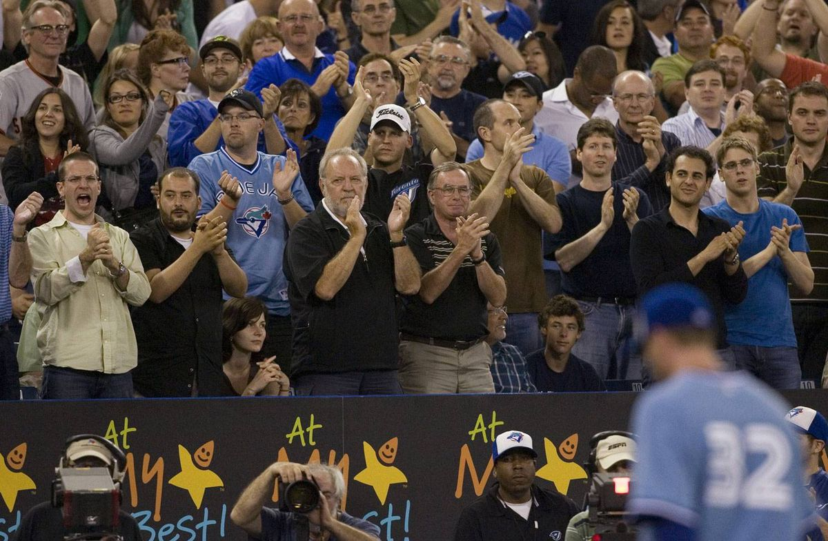 Toronto Blue Jays starting pitcher Roy Halladay is applauded by fans as he returns to the dugout during ninth inning AL action against Tampa Bay Rays in Toronto on Friday July 24, 2009. Halladay struck out 10 batters over nine innings but took a no-decision as the Tampa Bay Rays beat Toronto 4-2 in 10 innings. THE CANADIAN PRESS/Chris Young