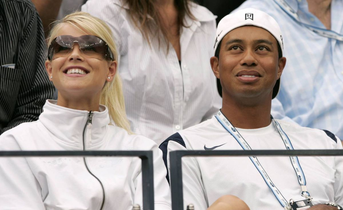 Tiger Woods attends the men's final match with his wife Elin Nordegren at the U.S. Open tennis tournament in New York on Sept. 10, 2006.