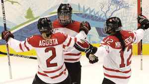 Canada's Marie-Philip Poulin celebrates the second of her two first-period goals with teammates Meghan Agosta and Meaghan Mikkelson during the gold medal game played at Canada Hockey Place in Vancouver during the 2010 Olympic Games.