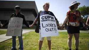 Canadian Union of Postal Workers (CUPW) members stand in front of a Canada Post sorting facility in Toronto, June 15, 2011. Canada's national postal system locked out its employees on Wednesday, saying more than a week of rotating strikes by its unionized workers had cost it too much money