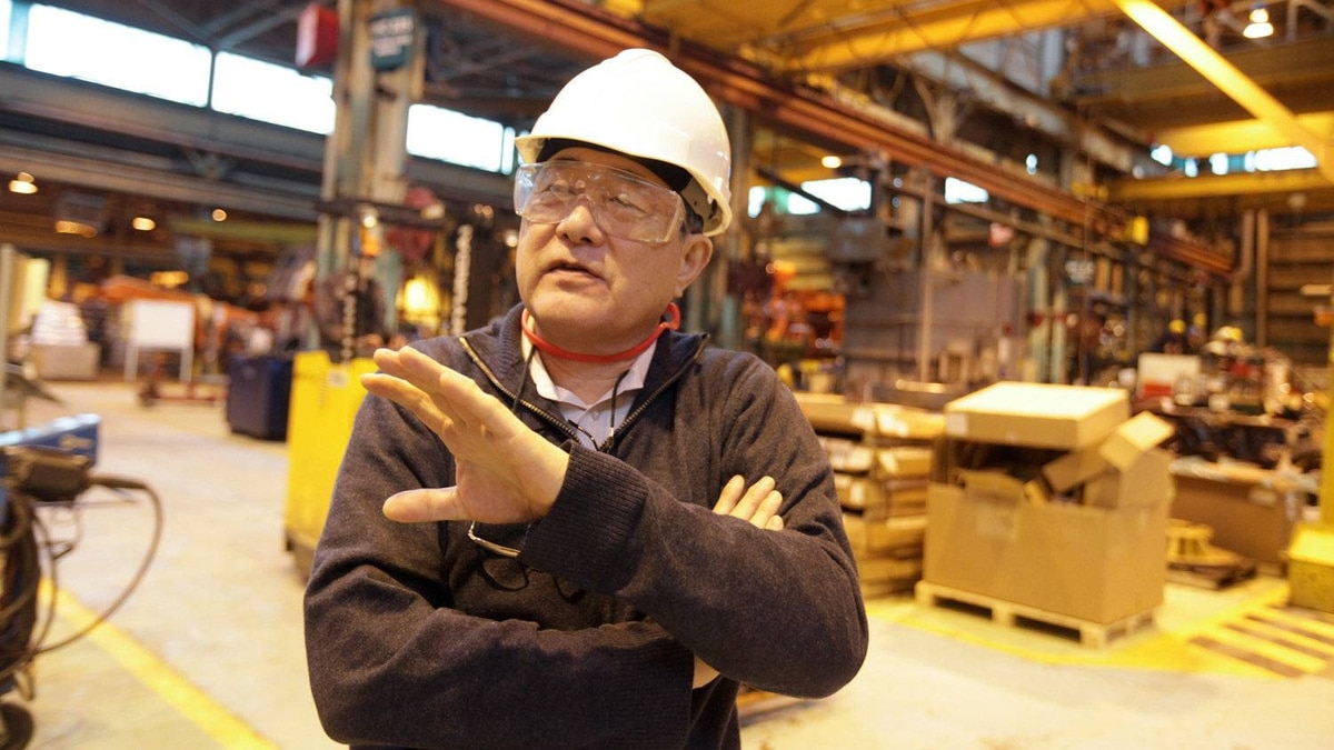 Hideo Kitawaki, CEO of Hitachi Construction Truck Manufacturing Ltd. in Guelph, Ont., tours his plant where they manufacture 200 giant industrial mining vehicles a year. A key reason he cites for expanding in Guelph instead of opening a new factory in a lower-cost location is the presence of a skilled and veteran work force at the plant.
