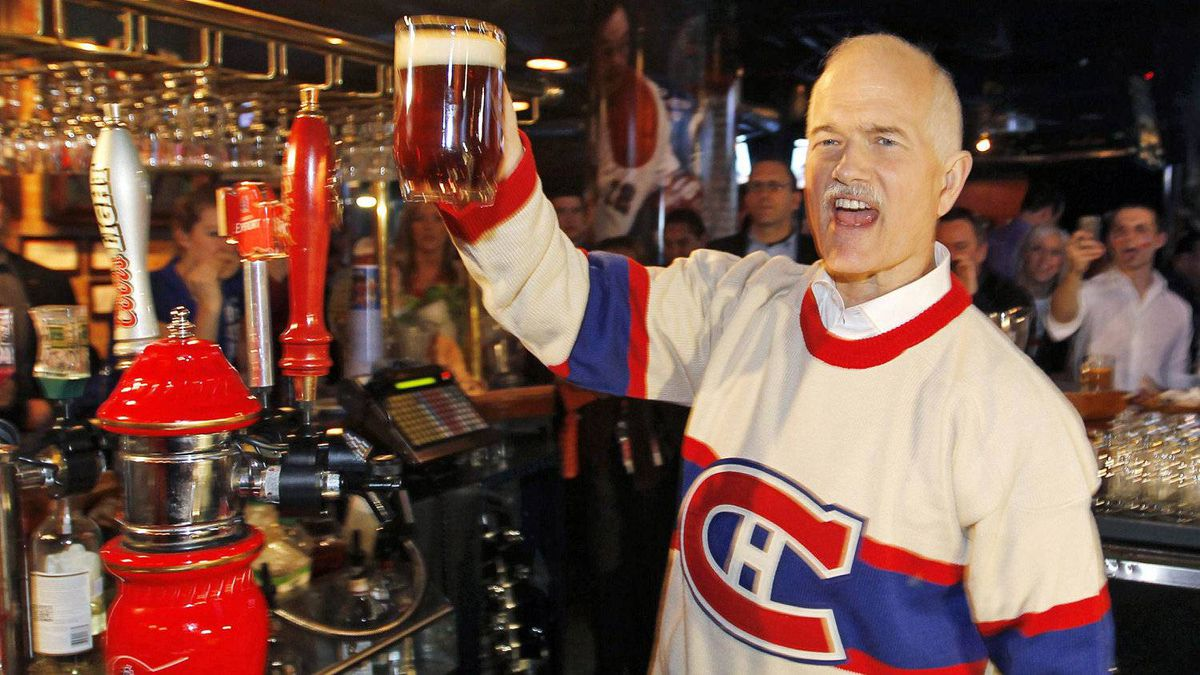 NDP Leader Jack Layton raises a pint during a campaign stop at a sports bar in Montreal during the Habs-Bruins playoff game on April 14, 2011.