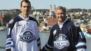 AHL St. John's IceCaps President and Chief Eecutive Officer Danny Williams and team right-winger Jason King, left, a native of Corner Brook, NL, unveil the teams new jerseys at Fort Waldegrave by the Outer Battery near St. John's Harbour, Thursday Sept. 22, 2011. The shoulder flash on the jerseys is that of their parent NHL club the Winnipeg Jets. THE CANADIAN PRESS/ Joe Gibbons