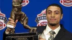 Hamilton Tiger-Cats wide receiver Chris Williams holds his award for the CFL Outstanding Rookie Thursday November 24, 2011 in Vancouver. The B.C. Lions will face the Winnipeg Blue Bombers in the 99th Grey Cup CFL football final Sunday. THE CANADIAN PRESS/Jonathan Hayward