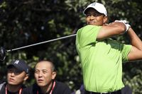 Tiger Woods hits the ball at the second tee during his practice round at the 2009 HSBC Champions golf tournament in Shanghai on Wednesday.