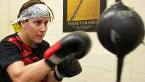 World Welterweight Champion, Mary Spencer hits a bag during a training session at the Windsor Amateur Boxing Club in Windsor, Ontario, May 6, 2010. GEOFF ROBINS The Globe and Mail