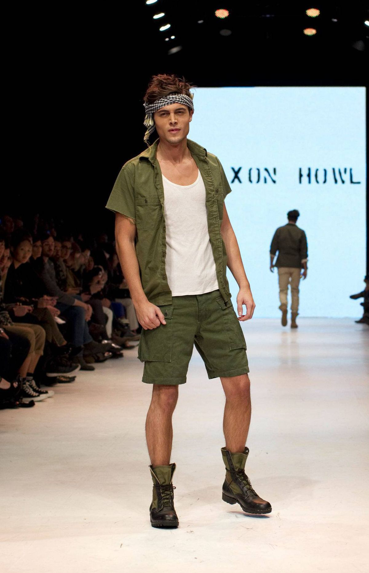"""Cargo pants and workman's shirts with rolled-up sleeves drove home the """"boys will be boys"""" vibe with an emphasis on pairing down the frills and focusing on the basics."""