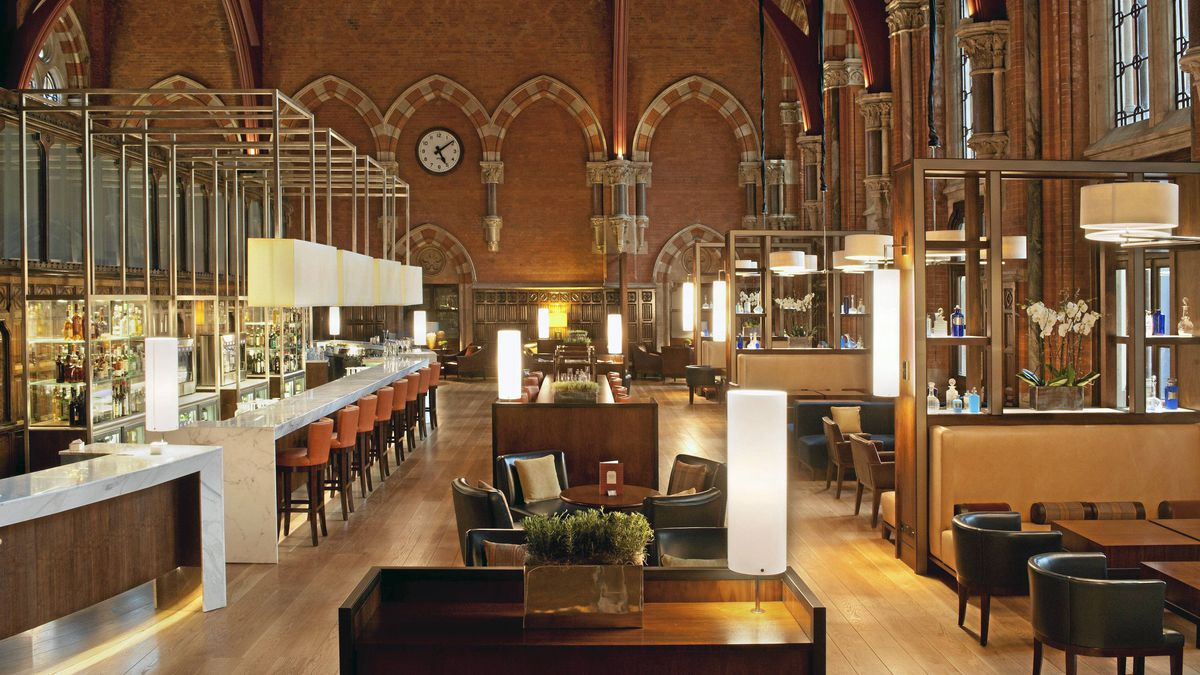 St. Pancras, London: The neglected Midland Hotel, which loomed in Gothic splendour over a rail terminal, reopened this year. The original wood-panelled booking office is now a stylish bar, while original carpets have been copied and deliberately faded. London's greatest Victorian building has been reborn. From $362. - Colin Amery