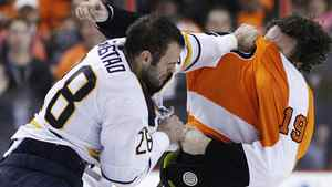 Buffalo Sabres' Paul Gaustad (28) and Philadelphia Flyers' Scott Hartnell (19) fight during the first period in Game 2 of a first-round NHL Stanley Cup playoffs hockey series, Saturday, April 16, 2011, in Philadelphia. (AP Photo/Matt Slocum)