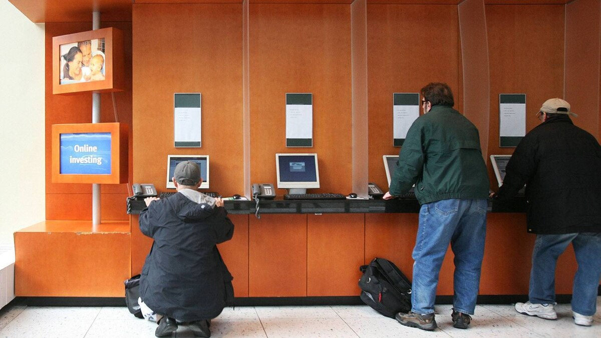 Customers at a TD Ameritrade office check online stock prices in this file photo.