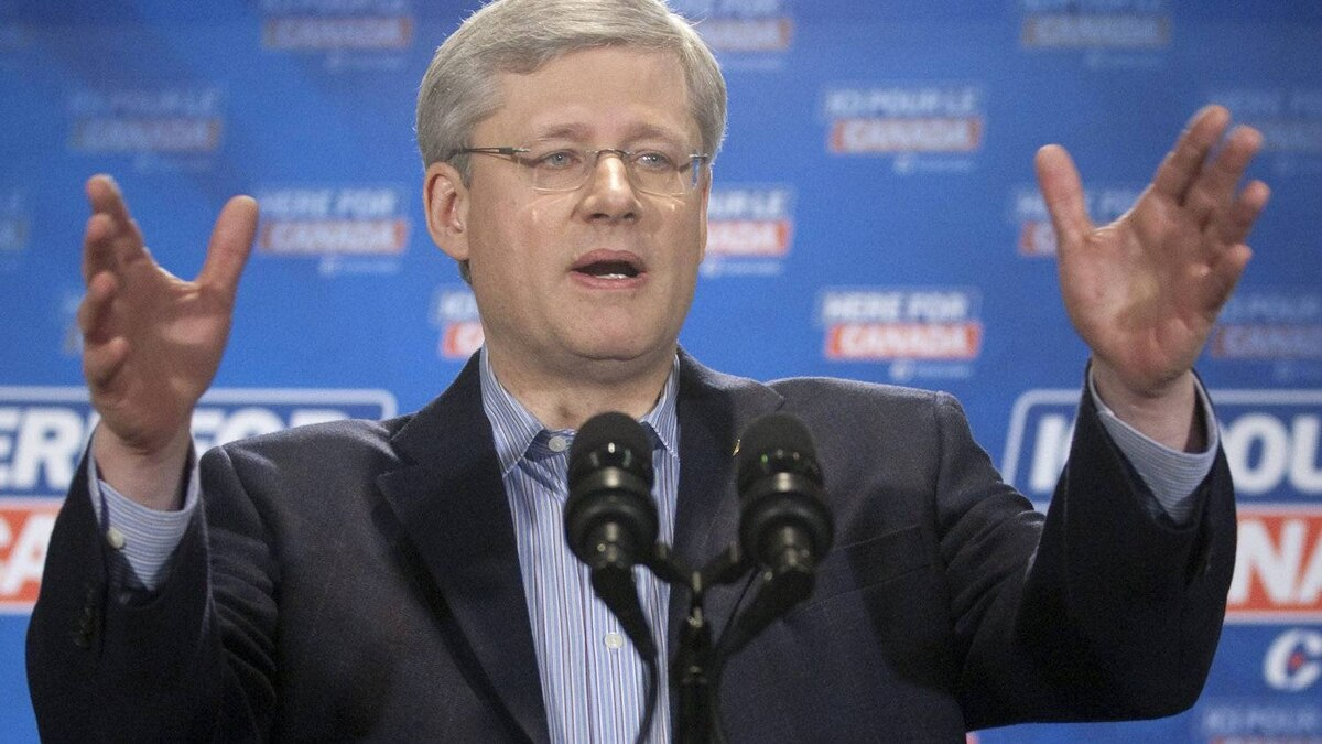 Prime Minister Stephen Harper gestures as he is questioned about coalitions during a media availability following a campaign speech in Brampton, Ont., Sunday March 27, 2011.