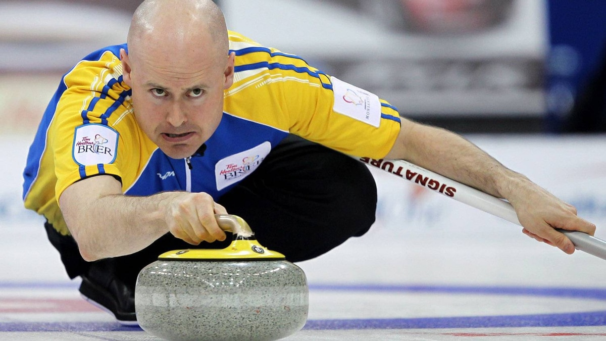 Alberta skip Kevin Koe makes a shot during an evening draw against British Columbia at the Tim Hortons Brier in Saskatoon on Saturday, March, 3, 2012. THE CANADIAN PRESS/Jonathan Hayward