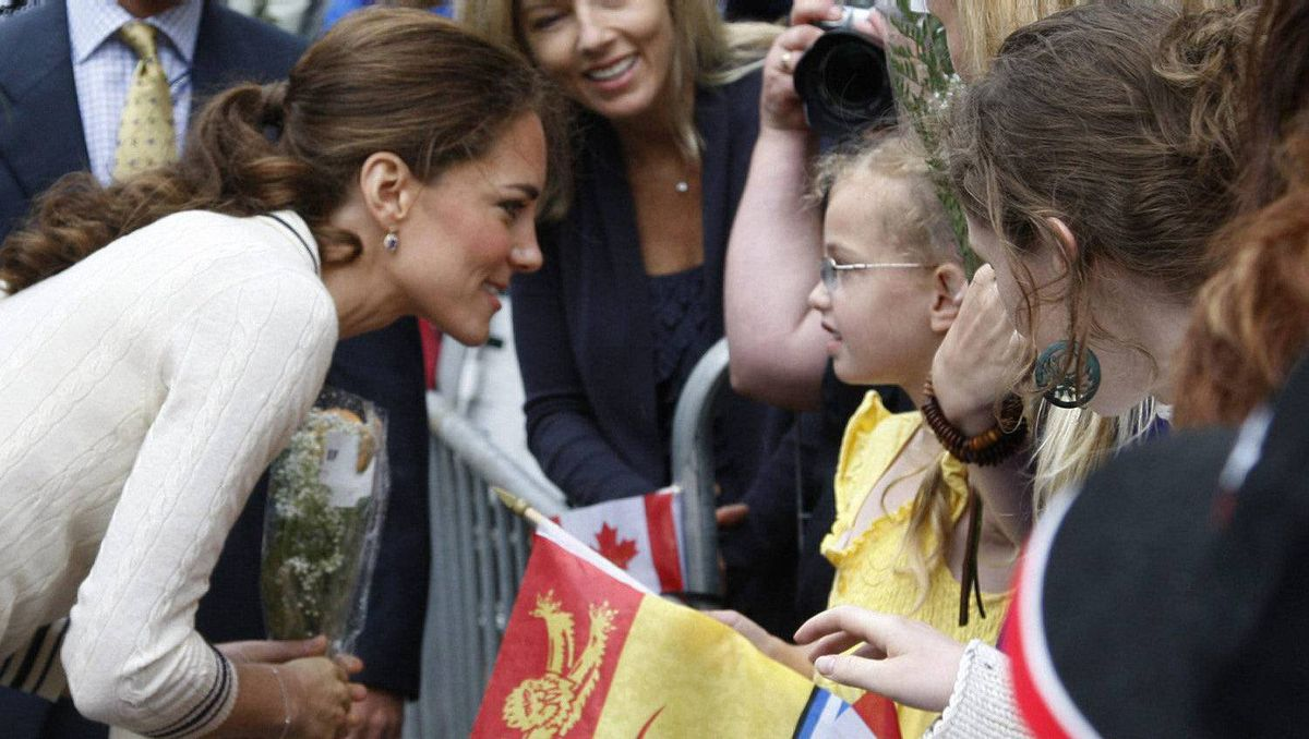 The Duchess of Cambridge greets a young girl in the crowd outside Province House in Charlottetown Monday, July 4, 2011.