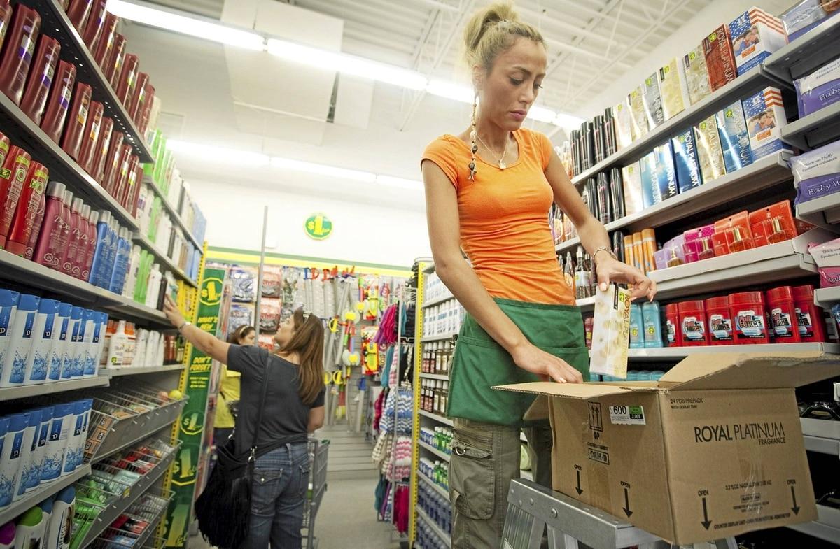 A Dollarama employee restocks shelves at the Dollarama store in Vaughan, Ont.