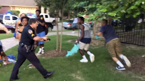 Texas officer on leave after video shows him pushing teen to ground, pointing gun at others