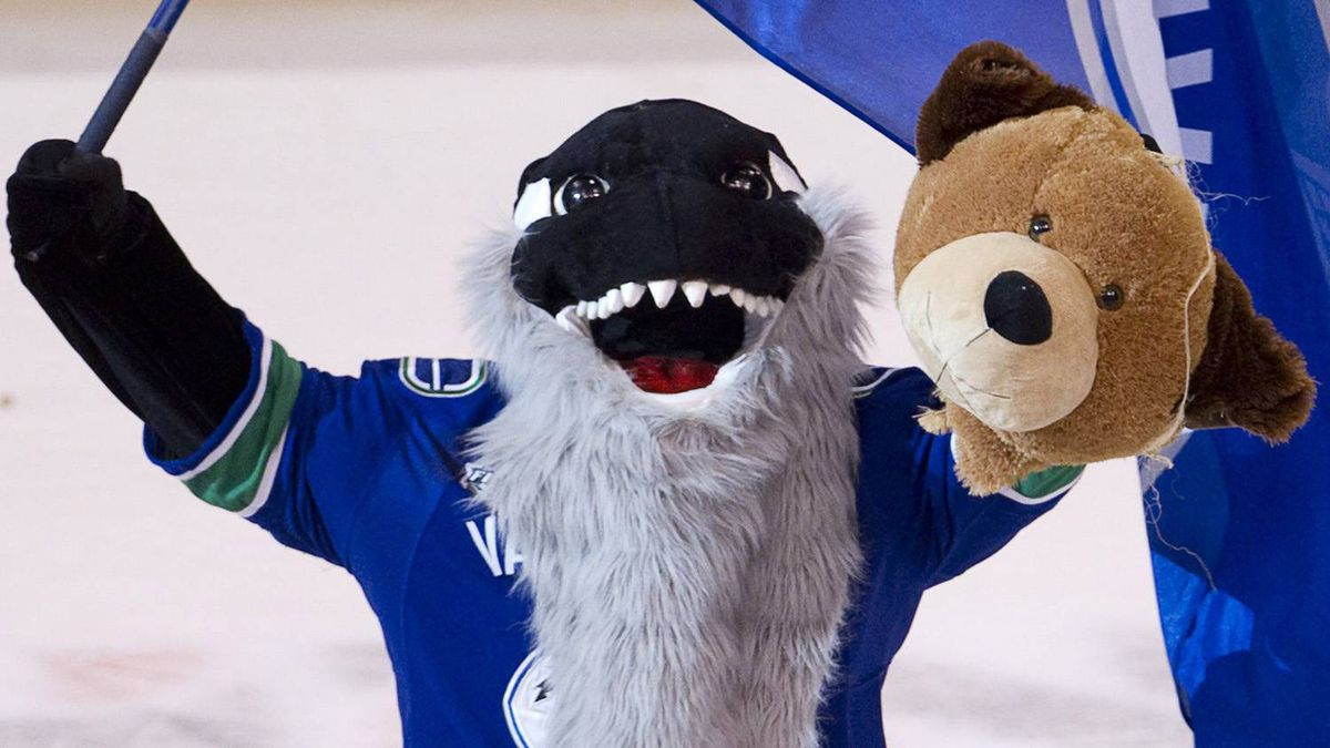 Fin the Vancouver Canucks mascot holds a bears head following the Canucks 1-0 win over the Boston Bruins in game 5 of the Stanley Cup hockey final in Vancouver, Friday, June 10, 2011. The Canucks lead the series 3-2. THE CANADIAN PRESS/Jonathan Hayward