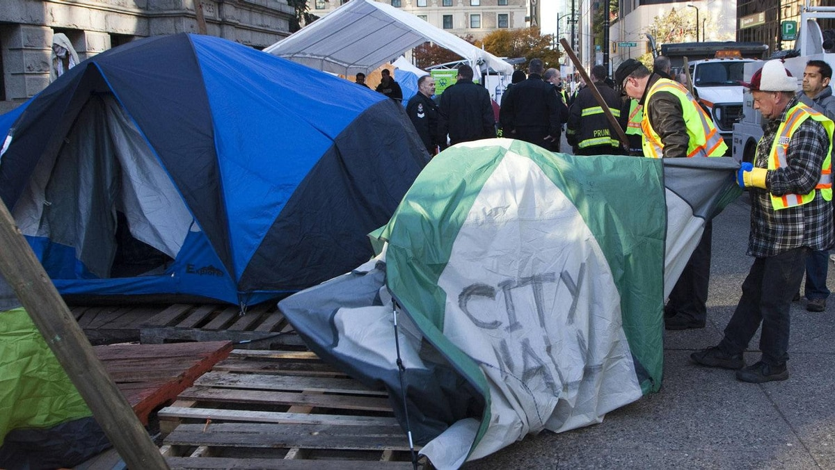 City workers remove a tent at the Occupy Vancouver protest site that did not comply with the fire code in Vancouver, British Columbia November 15, 2011.