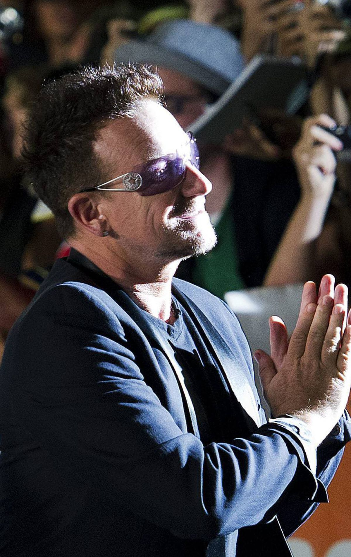 "U2 Lead Singer Bono greets the crowd before the screening of ""The Ides of March"" at the Toronto International Film Festival on Friday, Sept., 9, 2011. THE CANADIAN PRESS/Nathan Denette"