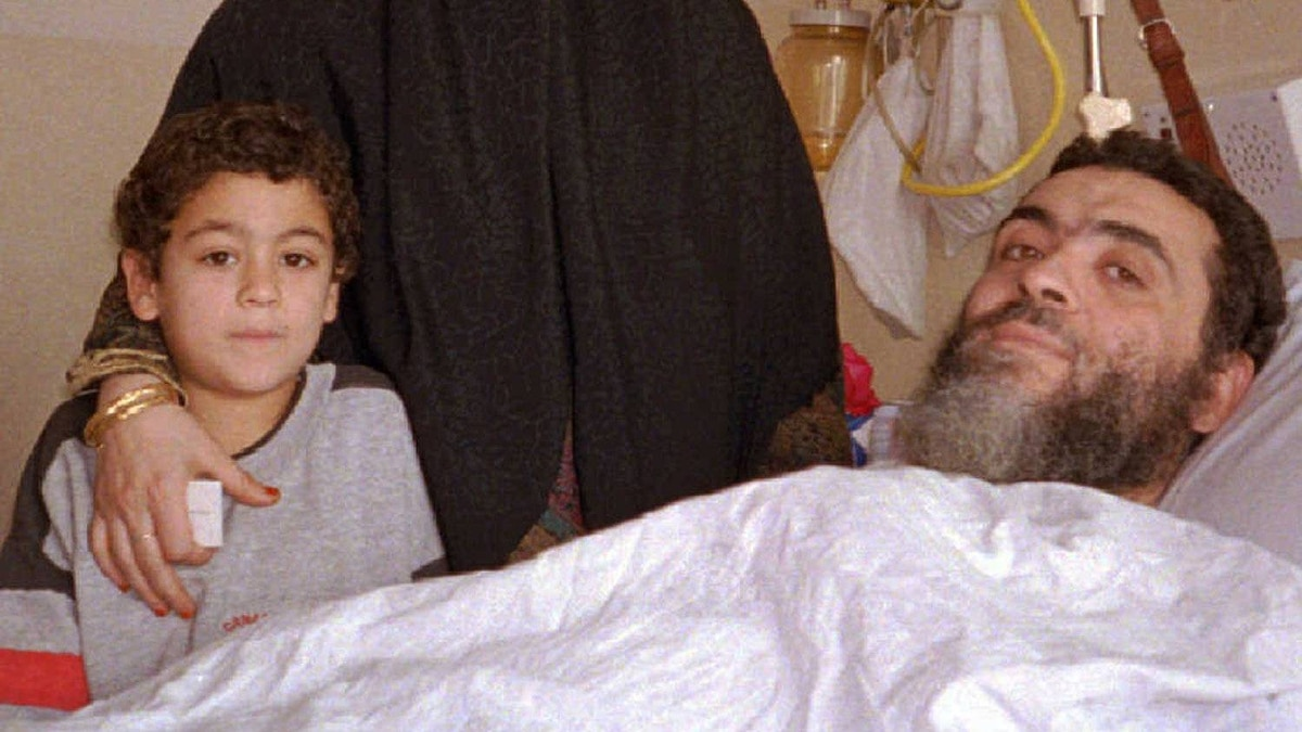 Ahmed Said Khadr,, a suspect in the suicide bombing of the Egyptian Embassy in Islamabad, is visited by his wife and one of his sons on Jan. 1, 1996, at a hospital in Islamabad.