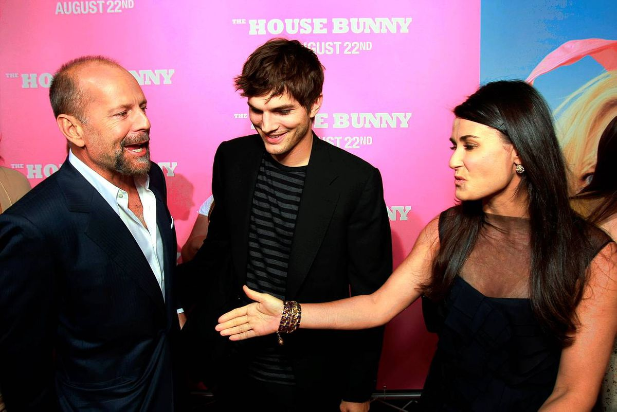 Demi Moore and husband Ashton Kutcher are known to be on good terms with her ex, Bruce Willis, left. They even vacation together.