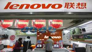 Customers talk to a salesperson at a Lenovo shop in Shanghai in this February 17, 2011 file photo. Lenovo Group Ltd, the world's No.2 PC maker by sales, reported a 59 percent rise in fourth-quarter net profit on May 23, 2012.