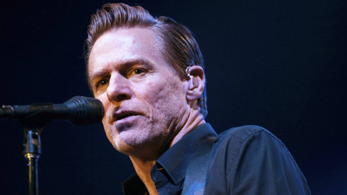 Canadian musician Bryan Adams performs during a concert in Beirut in this December 14, 2010 file photograph. Adams has become a father for the first time at the age of 51, People magazine reported on May 5, 2011.