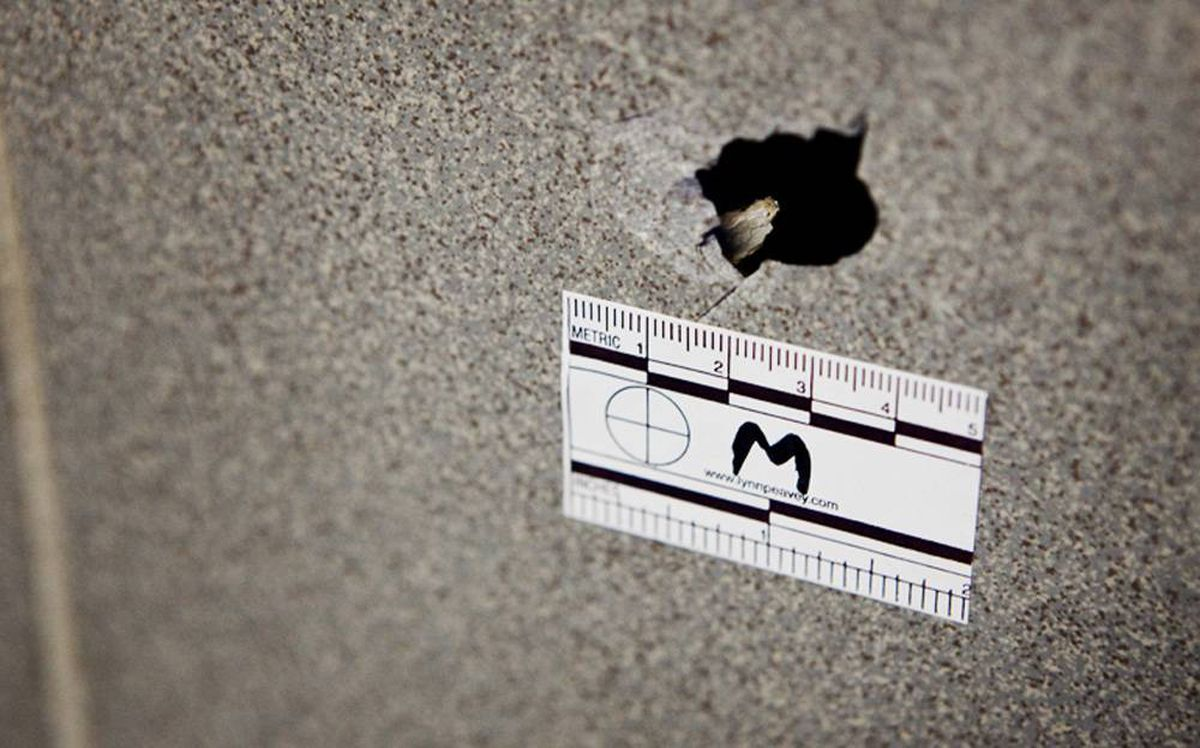 A bullet hole is seen in the wall inside the entrance way at 2468 Eglinton Avenue West were a male youth was shot in the leg during a drive-by.
