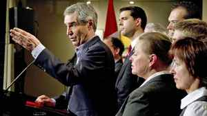 Liberal Leader Michael Ignatieff, flanked by local candidates, responds to a question during a news conference in Quebec City on April 28, 2011.