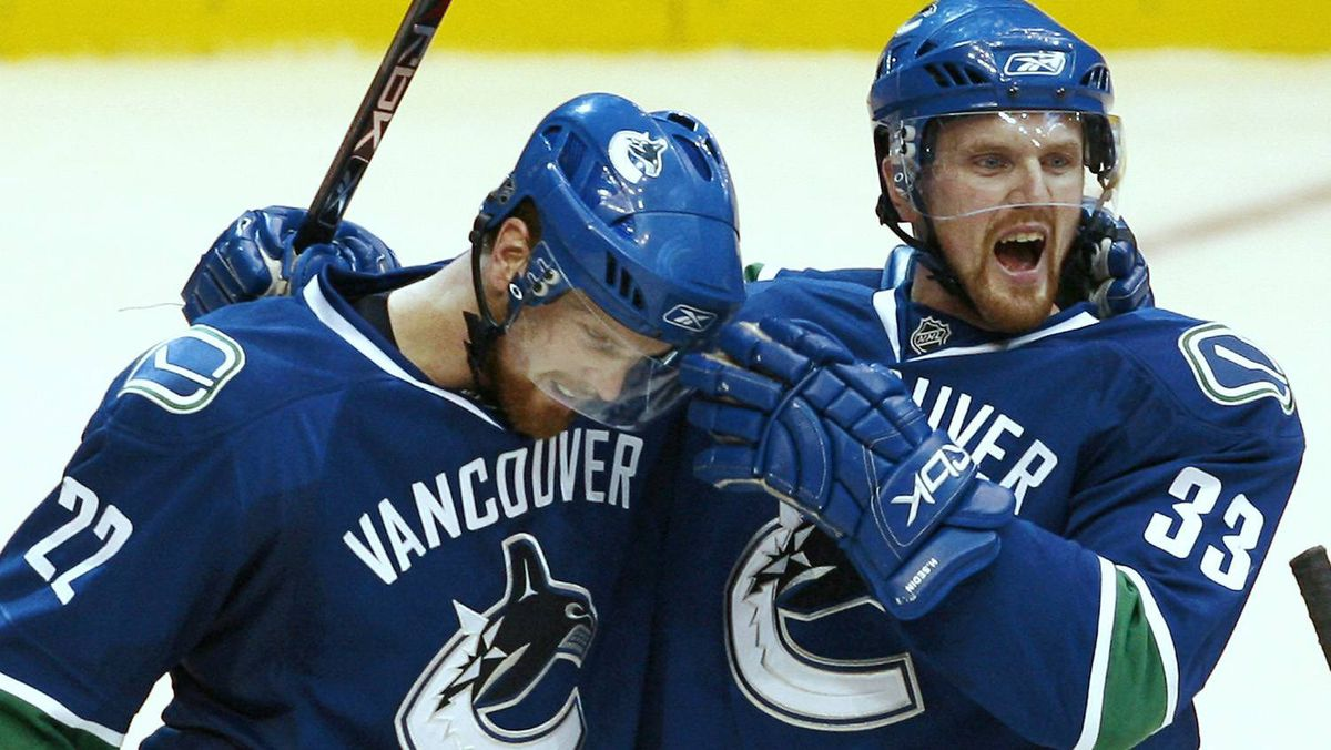 Vancouver Canucks' Daniel Sedin, left, is congratulated by his twin brother Henrik Sedin after Daniel scored against the Dallas Stars during the third period of their NHL hockey game in Vancouver, British Columbia December 20, 2007.