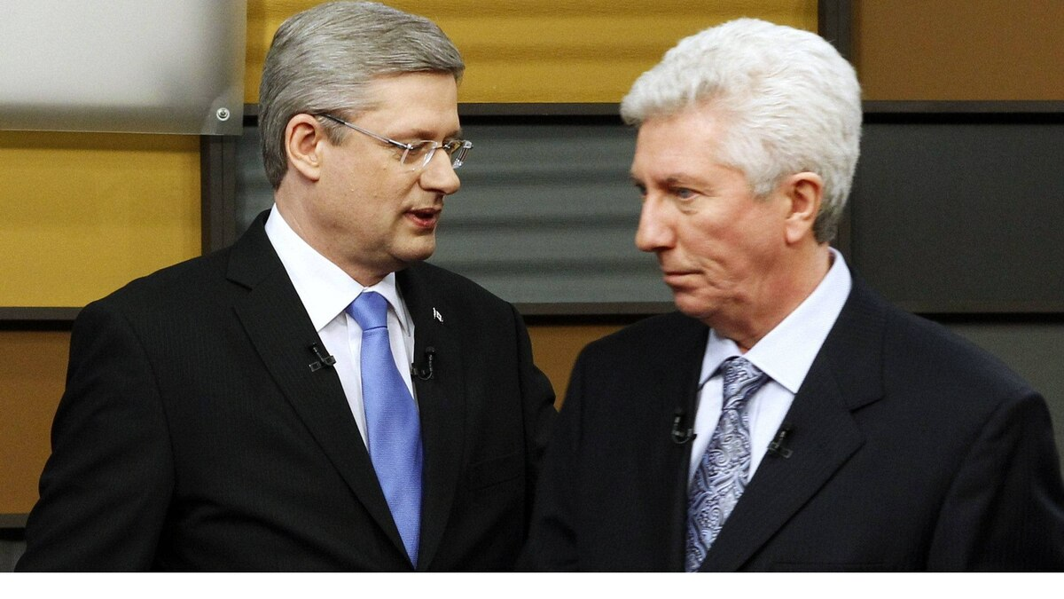 Canada's Prime Minister Stephen Harper (L) and Bloc Quebecois leader Gilles Duceppe meet prior to the French language leaders' debate in Ottawa April 13, 2011. Canadians will head to the polls in a federal election on May 2.