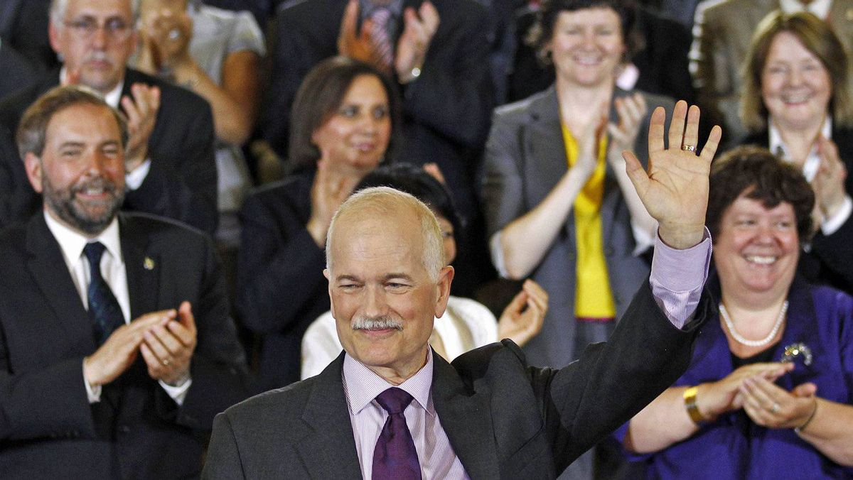 NDP Leader Jack Layton waves after delivering a speech to his caucus in Ottawa on May 24, 2011.