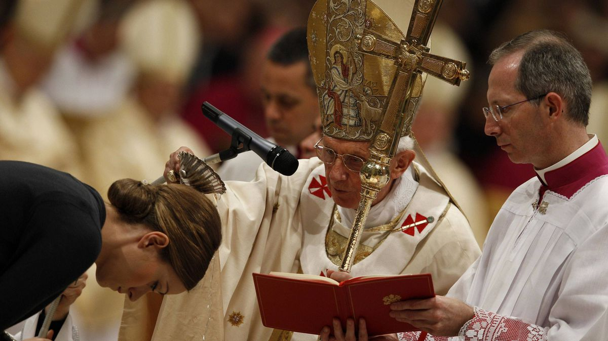 Pope Benedict XVI baptizes Daniela Venner from Germany at an Easter vigil in St. Peter's Basilica on Saturday.