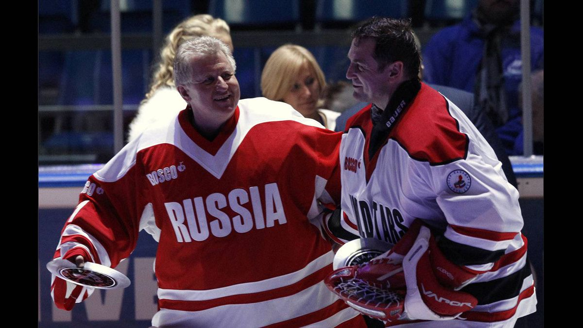 Russian legendary hockey goalkeeper Vladimir Myshkin, left, skates with the rival Czech Republic's former goalkeeper Peter Briza after an exhibition game in Moscow on Feb. 25, 2012 between teams of Russian and world stars to mark the anniversary of U.S.S.R.-Canada 1972 Summit Series.