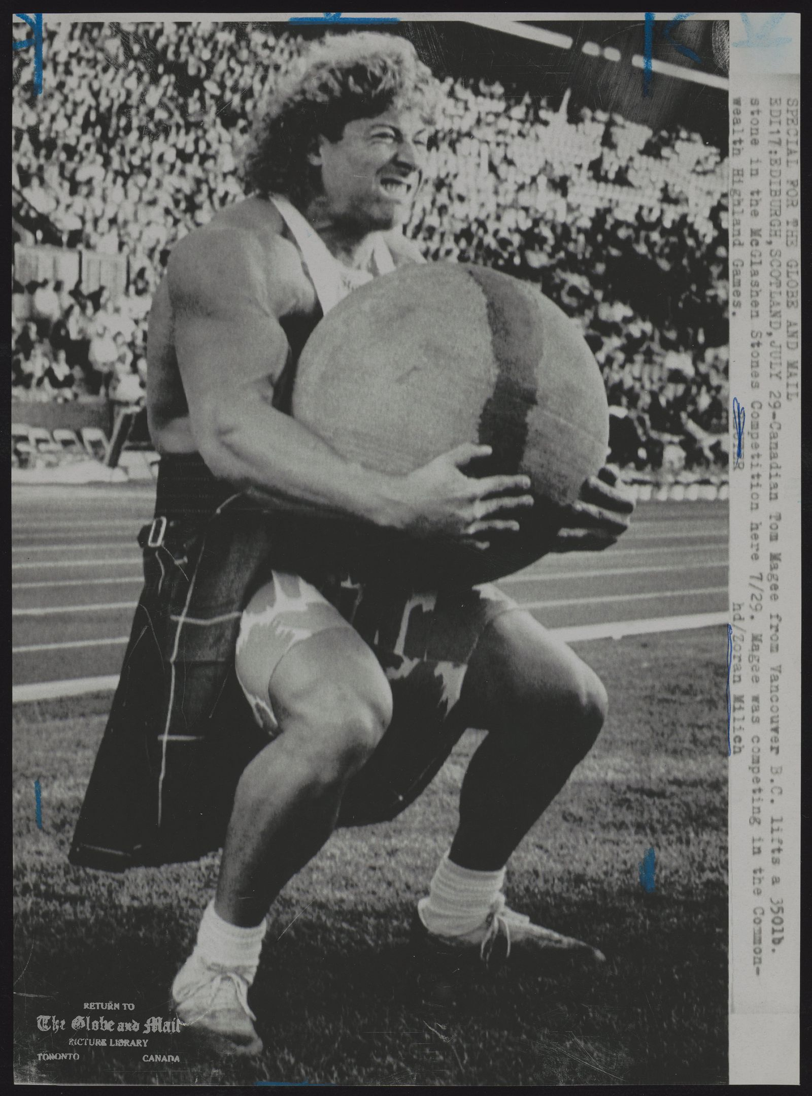 HIGHLAND GAMES SPECIAL FOR THE GLOBE AND MAIL EDI17:EDINBURGH,SCOTLAND,JULY 29-Canadian Tom Magee from Vancouver B.C. lifts a 350lb stone in the McGlashen Stones Competition here 7/29. Magee was competing in the Commonwealth Highland Games.