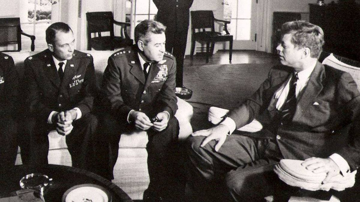 President John F. Kennedy meets with Air Force Maj. Richard 'Steve'' Heyser, left, and Air Force Chief of Staff, Gen. Curtis LeMay, center, at the White House in 1962 to discuss spy-plane flights over Cuba.