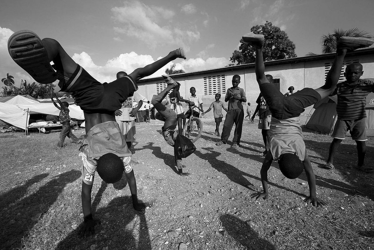 Jacmel, Feb. 18/10 - Children play in the yard of the Abri Pwovizwa Shelter Camp in Jacmel, Haiti. The group of families, some 500 homeless people are staying in the yard of a church/ health clinic in the neighbourhood their houses are in to stay close to whatever is left of their homes and have developed a small government to deal with food, water, security, children and other everyday life needs.