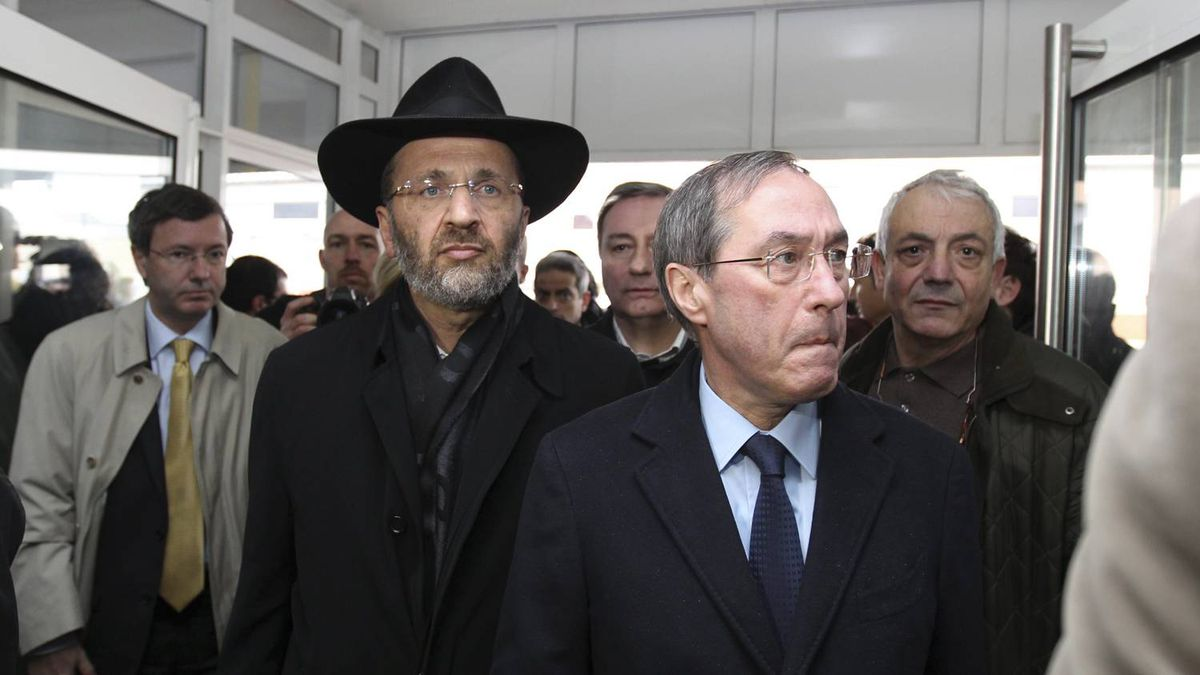 French interior minister, Claude Gueant, second from right, followed by France's chief rabbi, Gilles Bernheim, second from left, arrive at a Jewish school where a gunman opened fire killing four people in Toulouse, southwestern France, Monday, March 19, 2012