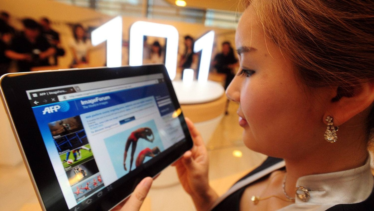A South Korean model holds a Samsung Galaxy Tab 10.1 during its launch at the company's main building in Seoul in July.