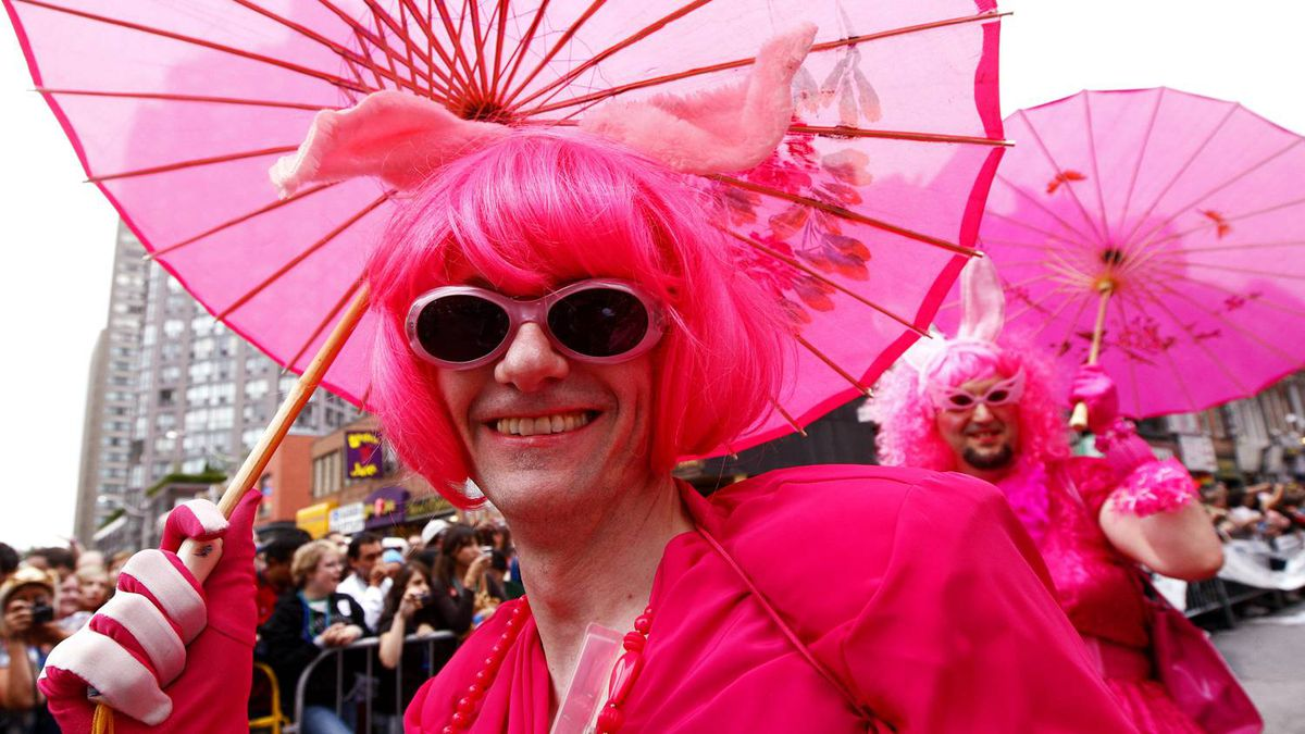 Revellers smile as they march down Yonge Street during the annual Pride Parade in Toronto on Sunday, June 28, 2009.