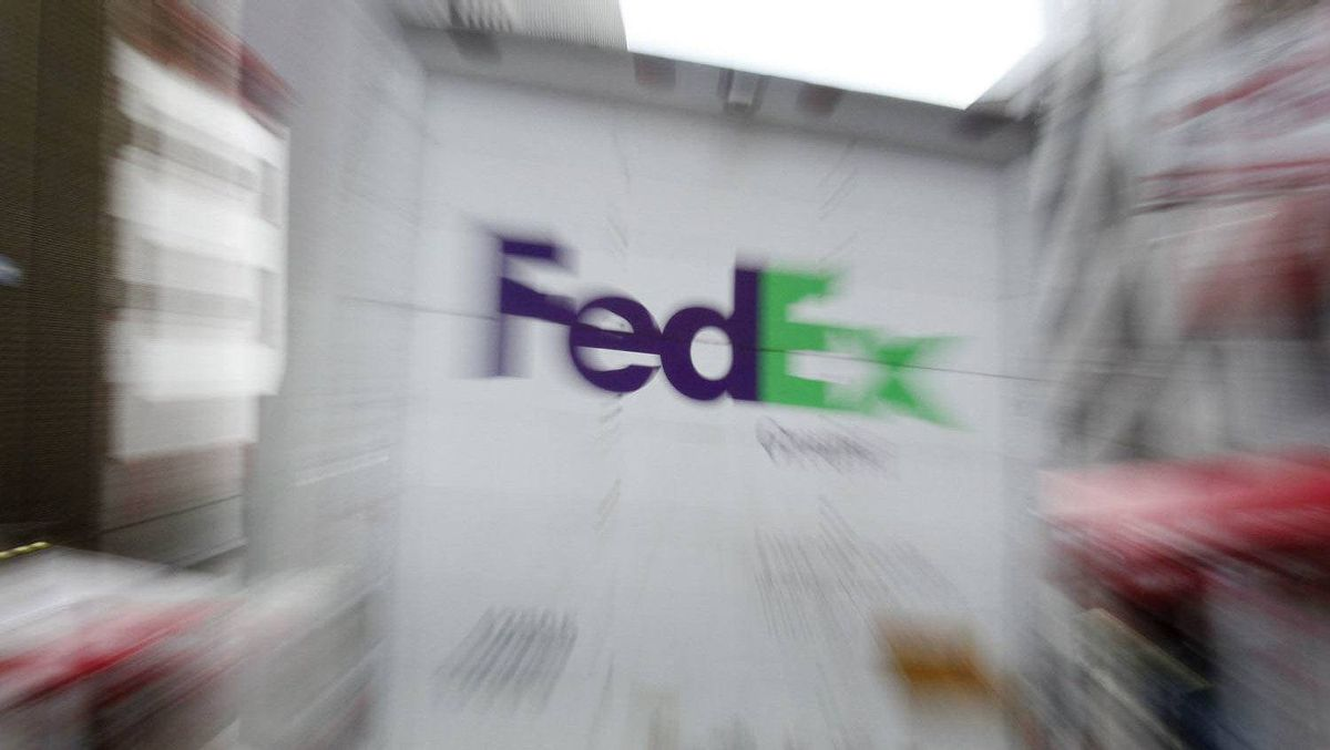 A FedEx delivery truck drives away from a delivery location in New York, December 14, 2009.