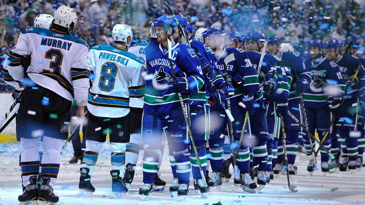 Captain Henrik Sedin of the Vancouver Canucks leads his team for the post game handshake with the San Jose Sharks after winning Game Five. (Photo by Rich Lam/Getty Images)