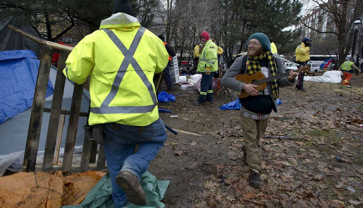 Toronto city workers clean up St. James Park as Police entered the park where Occupy Toronto protester are staying in Toronto, Ont. Nov. 23, 2011. Things remained peaceful as city workers began dismantling the tents and structures. (Kevin Van Paassen/The Globe and Mail)