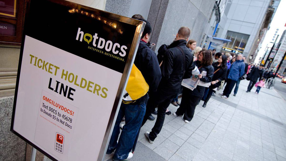 Filmgoers queue up for a screening at the Hot Docs festival in Toronto in April, 2011.