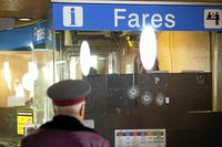 A TTC worker inspects bullet holes in the window of a fare booth at Dupont Station in Toronto, Ont. Feb. 27, 2011.