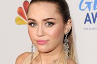 Actress/singer Miley Cyrus arrives at the American Giving Awards presented by Chase held at the Dorothy Chandler Pavilion on December 9, 2011 in Los Angeles.