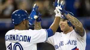 Toronto Blue Jays Edwin Encarnacion and Brett Lawrie celebrate after scoring during the sixth inning Tuesday.