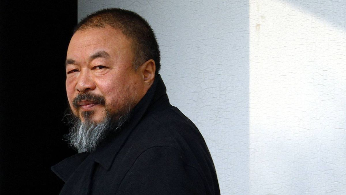 Dissident Chinese artist Ai Weiwei walks out of his studio in Beijing November 15, 2011. Mr. Ai's secretive 81-day detention this year sparked worldwide attention.