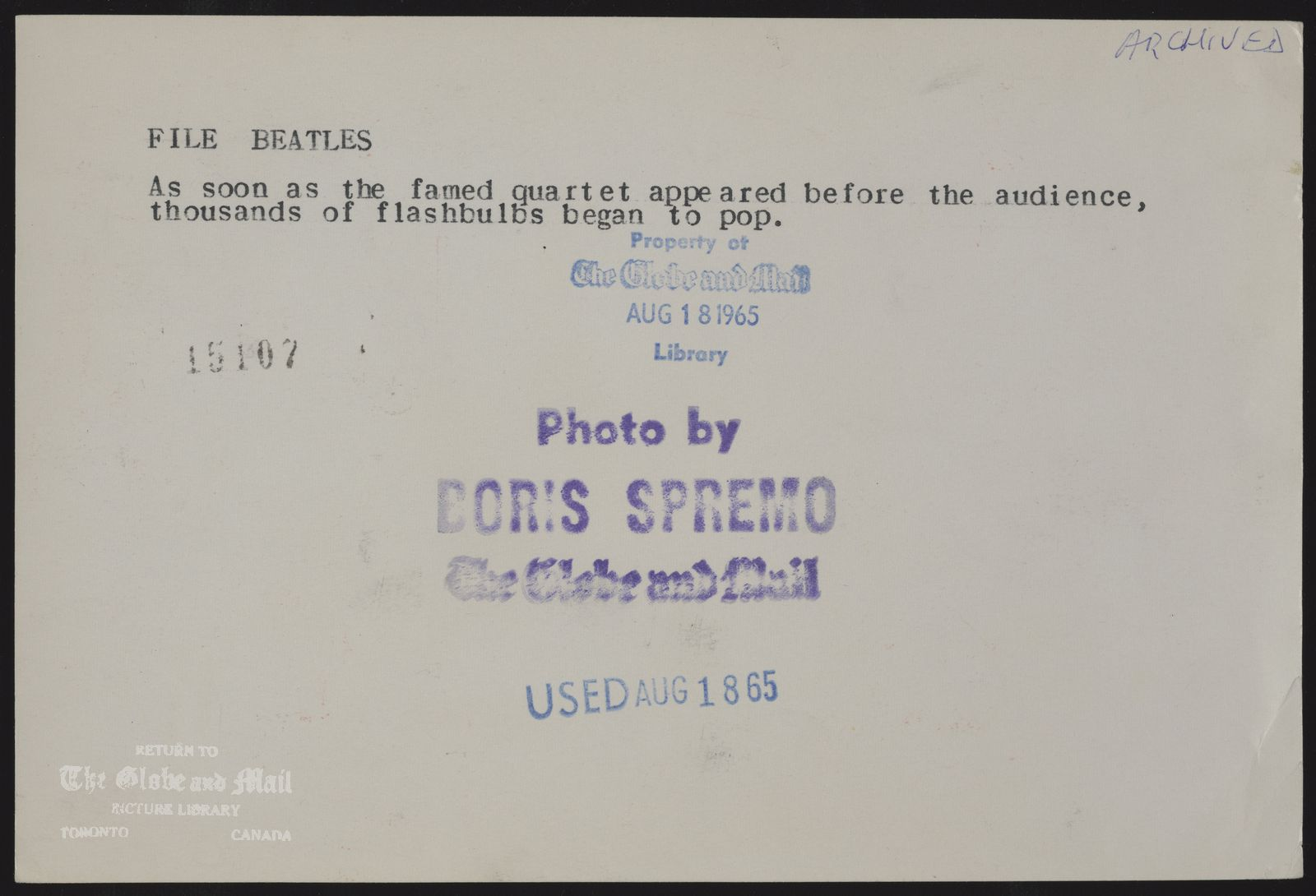 The notes written and typed on the back of this photograph, from the time it was printed, are as follows: BEATLES As soon as the famed quartet appeared before the audience, thousands of flashbulbs began to pop.August 18, 1965,BORIS SPREMO